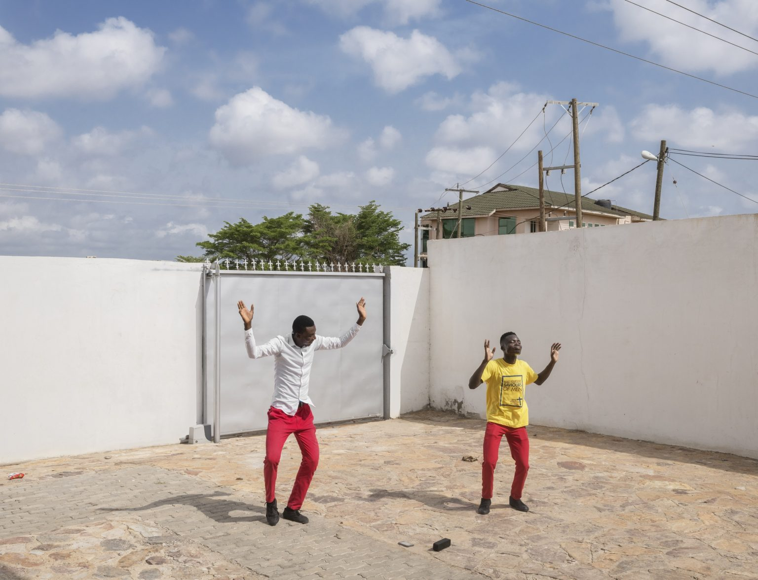 """Legon (Accra), Greater Accra Region, Republic of Ghana, April 2019 - Young worshipers dancing in the courtyard of Qodesh Family Church, The Qedesh, a Lighthouse Chapel International branch located in East Legon Hills and inaugurated in 2017.According to a Pew Research Center's report titled """"The Age Gap inReligionAround the World"""", Georgia and Ghana are the only two countries in the world where young people aged 18-39 are more religious than those aged 40 and above. Lighthouse Chapel International (LCI),  founded in 1988 by Dag Heward-Mills and headquartered in Accra it is considered to be one of the leading charismatic churches in Ghana, and has over 3000 branches in over 50 countries in Africa, Europe, Asia, the Caribbean, Australia, the Middle East and the Americas. Lighthouse Chapel International is one of the largest of the Pentecostal churches that have appeared since the late 1970s in cities in Africa. ><  Legon (Accra), Grande Regione di Accra, Repubblica del Ghana, aprile 2019 - Giovani fedeli danzano nel cortile della Qodesh Family Church, The Qedesh, sede della Lighthouse Chapel International situata a East Legon Hills ed inaugurata nel 2017.Secondo un rapporto del Pew Research Center intitolato """"The Age Gap in Religion Around the World"""", Georgia e Ghana sono gli unici due paesi al mondo in cui i giovani tra i 18 ei 39 anni sono più religiosi di quelli di 40 anni e oltre. Lighthouse Chapel International (LCI), fondata nel 1988 da Dag Heward-Mills e con sede ad Accra, è considerata una delle principali chiese carismatiche del Ghana e conta oltre 3000 filiali in oltre 50 paesi in Africa, Europa, Asia, i Caraibi, l'Australia, il Medio Oriente e le Americhe. Lighthouse Chapel International è una delle più grandi chiese pentecostali apparse dalla fine degli anni '70 nelle città dell'Africa."""