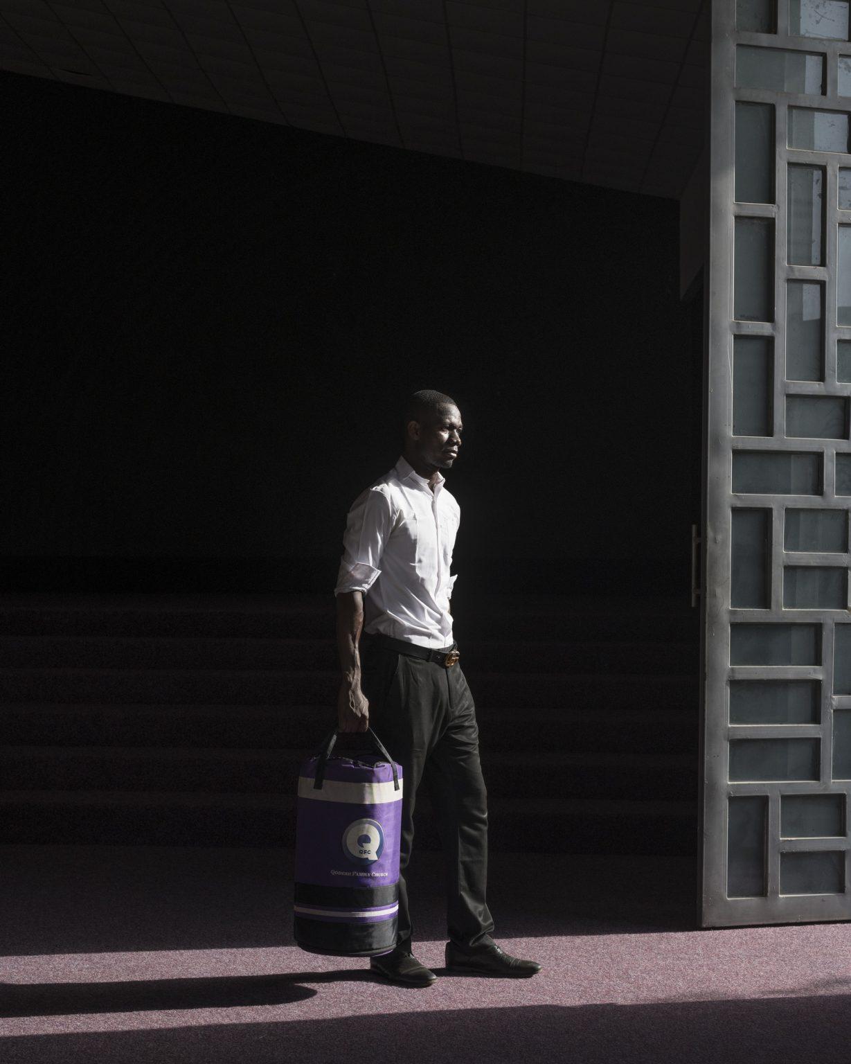 "Legon (Accra), Greater Accra Region, Republic of Ghana, April 2019 - Portrait of an usher at ""Qodesh Family Church, The Qedesh"". The Qedesh is a church of Lighthouse Chapel International inaugurated in 2017 and located in East Legon Hills district. Lighthouse Chapel International(LCI), founded in 1988 byDag Heward-Millsand headquartered inAccra it is considered to be one of the leading charismatic churches inGhana, and has over 3000 branches in over 50 countries inAfrica,Europe,Asia, theCaribbean,Australia, theMiddle Eastand theAmericas. Lighthouse Chapel International is one of the largest of the Pentecostal churches that have appeared since the late 1970s in cities in Africa. Its founder is nowadays considered among the richest pastors in Ghana. ><  Legon (Accra), Grande Regione di Accra, Repubblica del Ghana, aprile 2019 - Ritratto di un usciere presso ""Qodesh Family Church, The Qedesh"". The Qedesh è una chiesa della Lighthouse Chapel International inaugurata nel 2017 e situata nel distretto di East Legon Hills. Lighthouse Chapel International (LCI), fondata nel 1988 da Dag Heward-Mills e con sede ad Accra, è considerata una delle principali chiese carismatiche del Ghana e conta oltre 3000 filiali in oltre 50 paesi in Africa, Europa, Asia, i Caraibi, l'Australia, il Medio Oriente e le Americhe. Lighthouse Chapel International è una delle più grandi chiese pentecostali apparse dalla fine degli anni '70 nelle città dell'Africa. Il suo fondatore è oggi considerato tra i pastori più ricchi del Ghana."