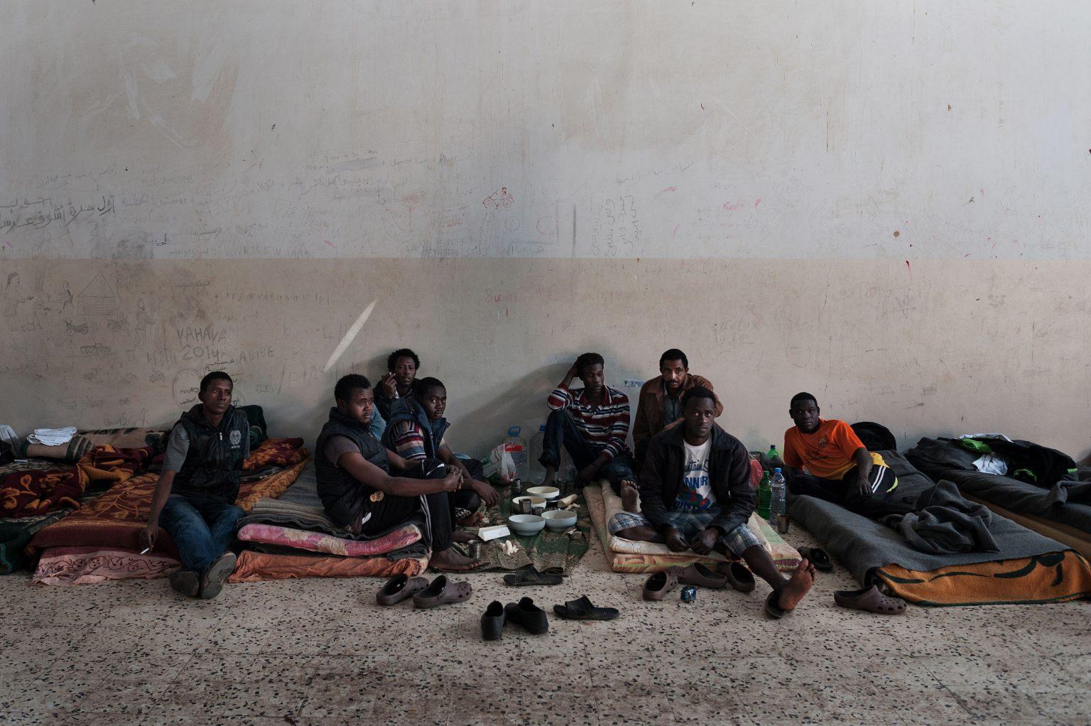 Tripoli, Libya, May 2014 - Twaisha prison for illegal immigrants - Eritrean and Sudanese immigrants. Every month more than 150 immigrants from sub-Saharian Africa are imprisoned in this detention centre. ----- Before boarding towards Europe, illegal migrants escaping from East Africa have to undertake the arduous crossing of the Sahara Desert, often facing torture, violence and unjust imprisonment.  ><  Tripoli, Libia, maggio 2014 - Prigione di Twaisha per persone senza documenti - Immigrati clandestini eritrei e sudanesi. Ogni mese più di 150 immigrati provenienti dall'Africa subsahariana vengono incarcerati qui. ----- Prima di imbarcarsi verso l'Europa, i migranti clandestini scappati dall'Africa Orientale devono  attraversare il Deserto del Sahara, affrontando spesso torture, violenza e ingiusti imprigionamenti.  *** Local Caption *** 00543825