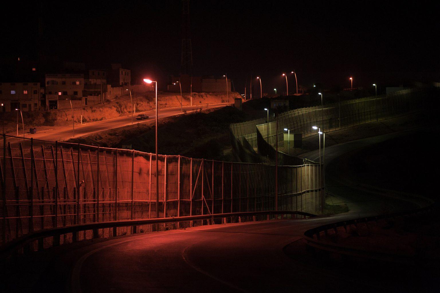 Melilla, Spain, August 2014 - The 12km fence that divides Spain and Morocco >< Melilla, Spagna, agosto 2014 - La rete metallica di confine tra Spagna e Marocco, lunga 12 km *** Local Caption *** 00534489
