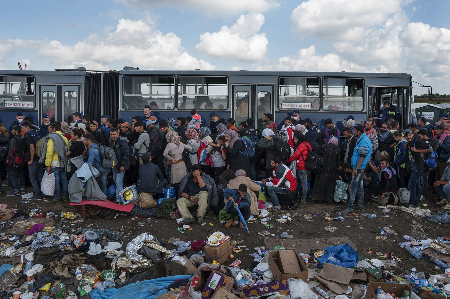 Roszke, Hungary,  September 12th 2015 - Refugees just arrived from Serbia waiting in line in order to be taken by bus to the refugee camp managed by the Hungarian government, where they will be registered and fingerprinted.      ------         The Hungarian government stated within September 15th the border definitively will be closed, in order to stop the flux of refugees coming from Serbia. According to surveys, during the day of September the 12th more than 4,000 people crossed the border between the two countries.    ><      Röszke, Ungheria, 12 settembre 2015 - Profughi appena arrivati dalla Serbia in coda in attesa di essere portati con un autobus nel campo profughi gestito dal governo ungherese, dove saranno registrati e schedati.              -------------              Il governo ungherese ha dichiarato che entro il 15 settembre il confine sarà definitivamente chiuso per interrompere il flusso di immigrati provenienti dalla Serbia. Secondo le stime, solo nel giorno 12 di settembre più di 4.000 persone hanno attraversato il confine tra le due nazioni.    *** Local Caption *** 00557239
