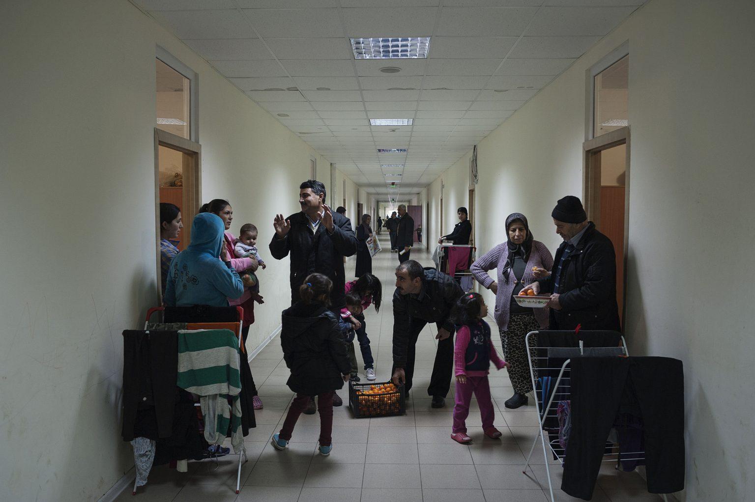 Harmanli, Bulgaria, December 2014 - Fruit distribution in the refugee center managed by the government.    -------         Since 2013 the number of the refugees entered in the country is raised, but Bulgaria is only a transit point for these people, that in great part want to reach northern european countries. Many refugees wait to receive the passport of 3 or 5 years as asylum seeker, but in the first case, this kind of document doesn't allow the person to leave the country.          ><  Harmanli, Bulgaria, dicembre 2014 - Distribuzione di frutta nel centro profughi gestito dal governo.  ------        Dal 2013 il numero dei rifugiati entrati nel paese è aumentato, ma la Bulgaria è solo un punto di transito per queste persone, che in gran parte vogliono raggiungere i paesi del Nord Europa. Molti profughi aspettano per ricevere il passaporto di rifugiato politico di durata di tre o cinque anni. Ma il passaporto di tre anni non permette al profugo di lasciare la nazione.  *** Local Caption *** 00557592