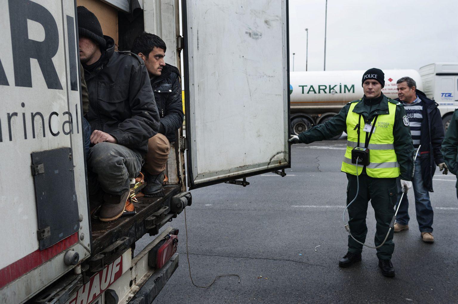 Lesovo, Bulgaria, December 2014 - Border policemen showing how they found 3 of the 5 Afghan boys in a truck coming from Turkey. The three boys were just brought out to be identified in the security cell; police officers asked migrants to reposition themselves in the truck, in the same manner in which they were found a few minutes before. Officers say that since January 2013 more than 1,300 refugees crossed the border hiding themselves in the trucks coming from Turkey.       -------         Since 2013 the number of the refugees entered in the country is raised, but Bulgaria is only a transit point for these people, who in large part want to reach the northern European countries.     ><  Lesovo, Bulgaria, dicembre 2014 - Poliziotti al confine mostrano come hanno trovato tre dei cinque ragazzi afghani nascosti in un camion proveniente dalla Turchia. I tre ragazzi sono stai appena tirati fuori per essere identificati nelle celle di sicurezza. La polizia ha chiesto agli immigrati di rimettersi nel camion nella stessa posizione in cui sono stati trovati qualche minuto prima  -     La polizia sostiene che da gennaio 2013 più di 1.300 profughi hanno attraversato il confine nascosti nei camion provenienti dalla Turchia.  ------        Dal 2013 il numero dei rifugiati entrati nel paese è aumentato, ma la Bulgaria è solo un punto di transito per queste persone, che in gran parte vogliono raggiungere i paesi del Nord Europa.    *** Local Caption *** 00557606