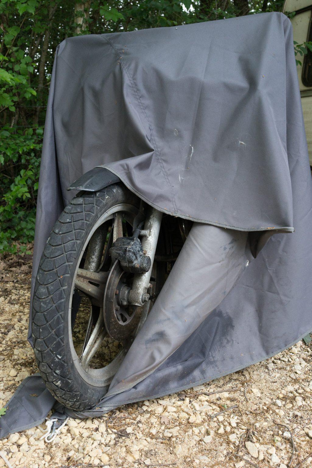 Valdivienne, France, May 2018 - An old motorbike from Tristan Plot, no longer used, covered for the rain. ><  Valdivienne,, Francia, maggio 2018 - Una vecchia motocicletta di Tristan Plot, non più usata, coperta per la pioggia.*** SPECIAL   FEE   APPLIES *** *** Local Caption *** 01489334