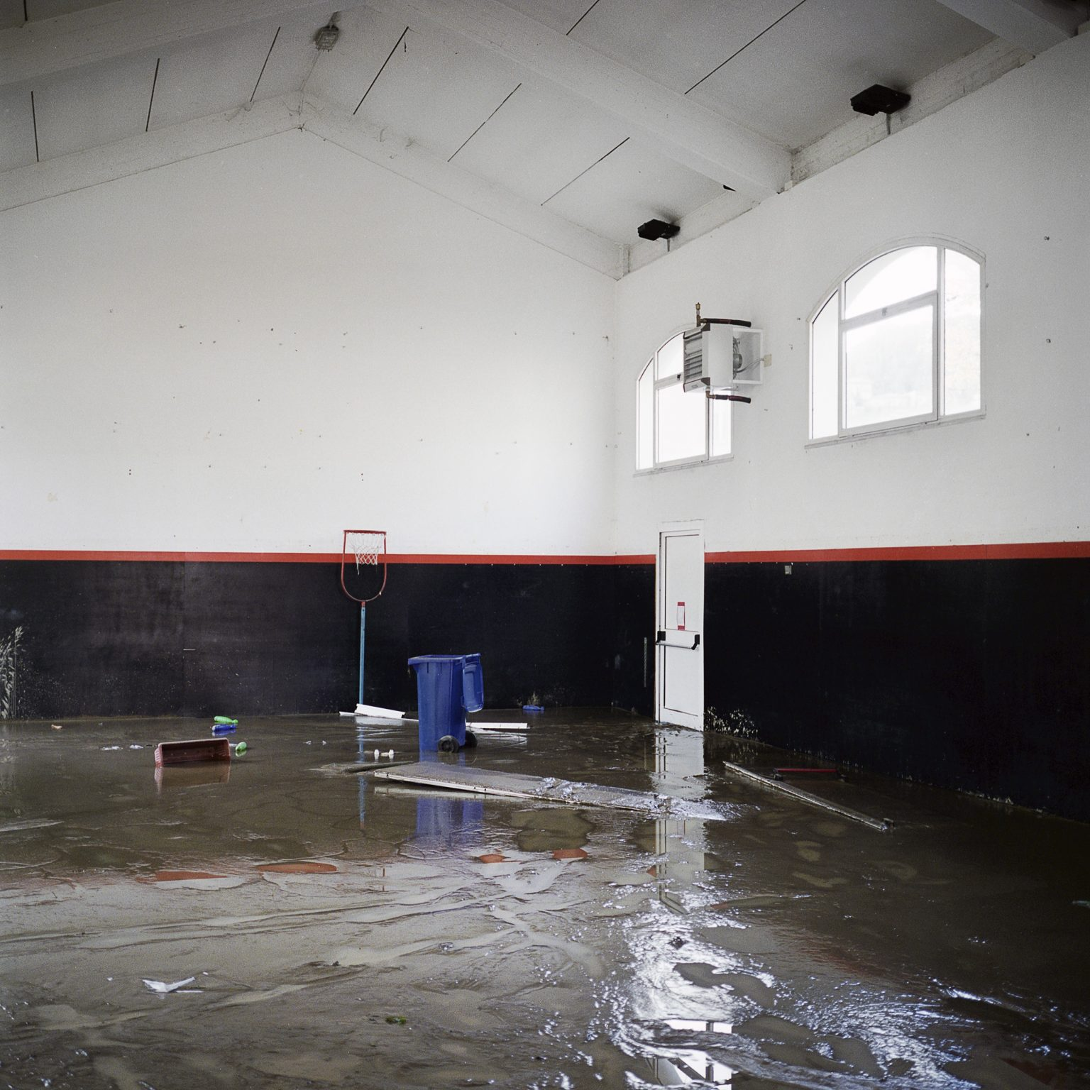 Aulla, October 2011. The day after the flood that hit the town due to the Magra river. The flooding caused 2 deaths and much damages to the buildings and economic activities. Inside the gym of a school.
