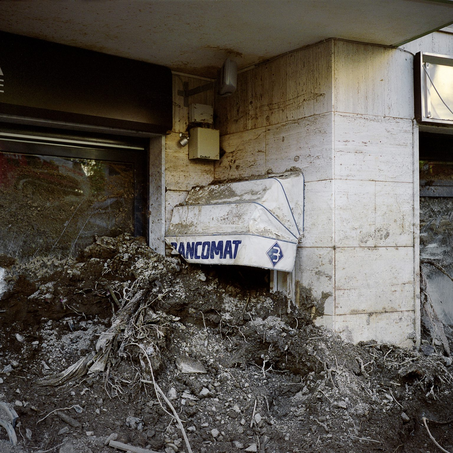 Monterosso al Mare, 5 Terre, October 2011. After the intense rain the town was hit by a severe flood that caused 1 death and much damage to the buildings and economic activities. An ATM machine in the main road of Monterosso covered in mud