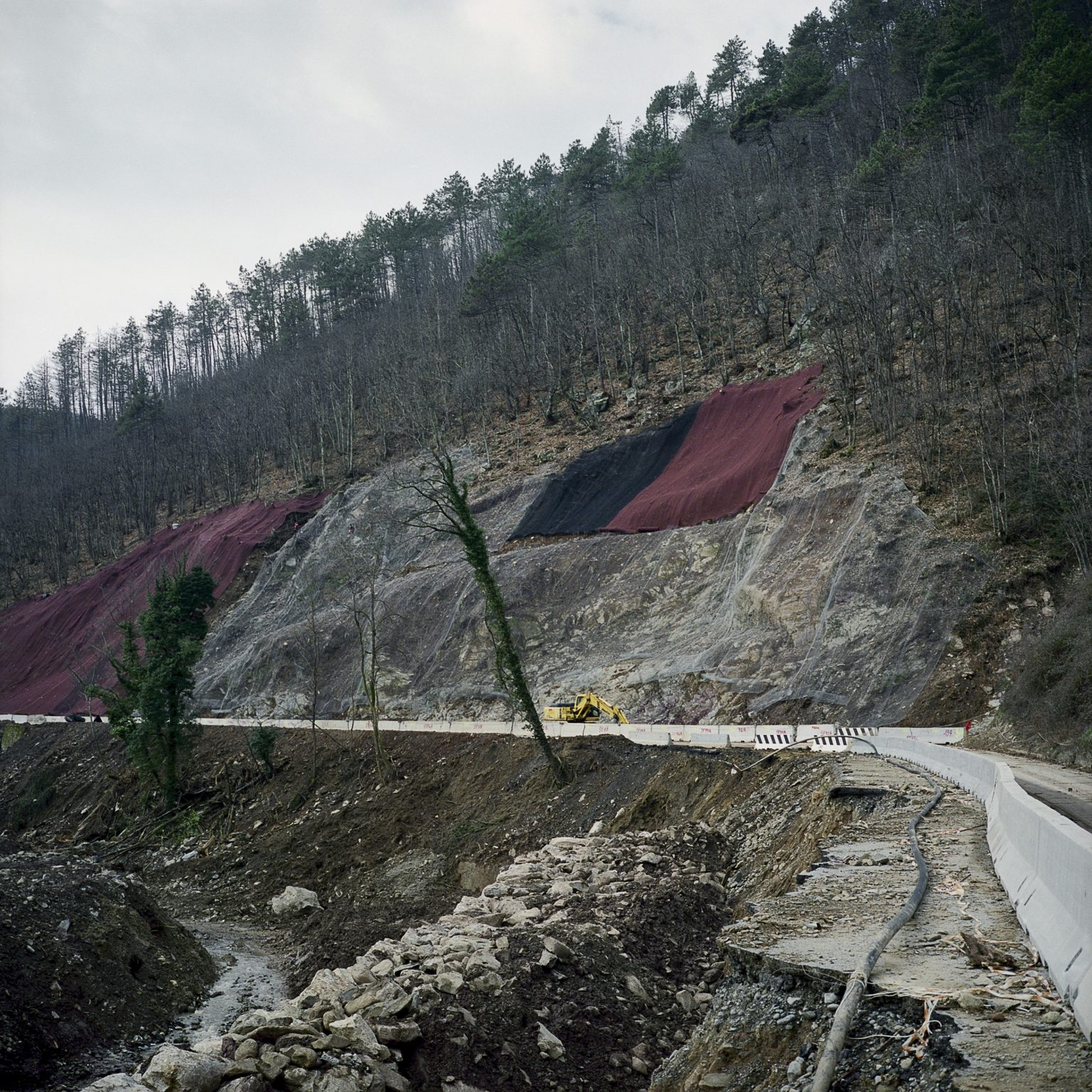 On the road from Pignone towards the sea coast, January 2012. The side of a hill is being covered due to the danger of landslides.