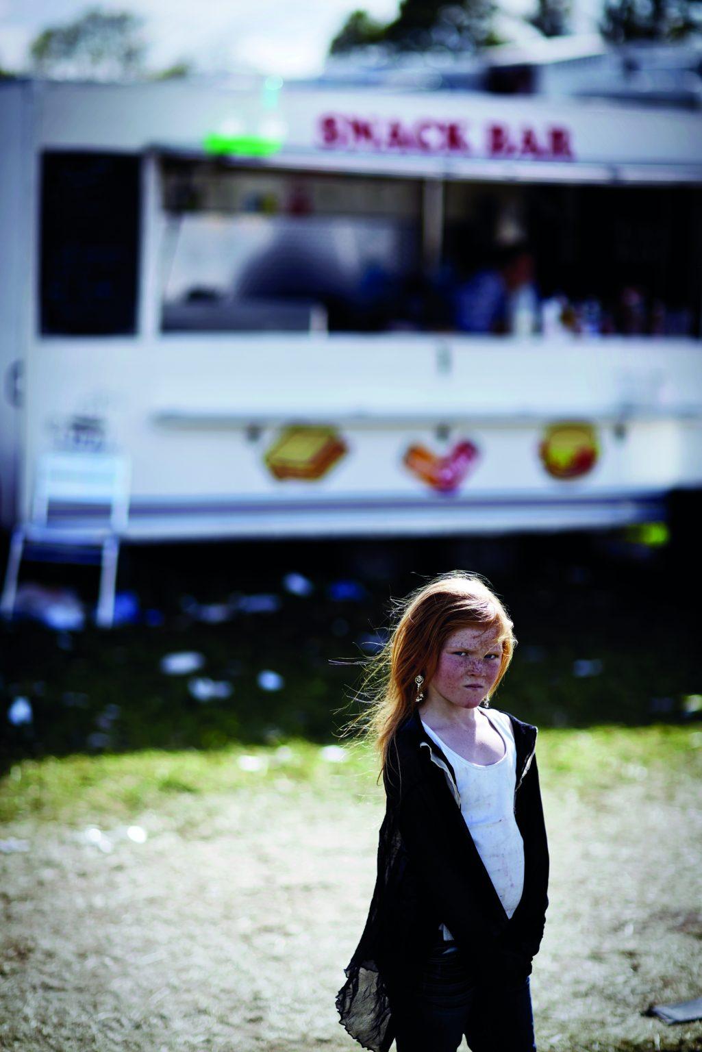 Appleby, United Kingdom, June 2015 - Appleby Horse Fair. Rose standing in front of her mum's hamburger stand. ><  Appleby, Regno Unito, giugno 2015 - Appleby Horse Fair. Rose in piedi di fronte al chiosco di sua madre. *** Local Caption ***