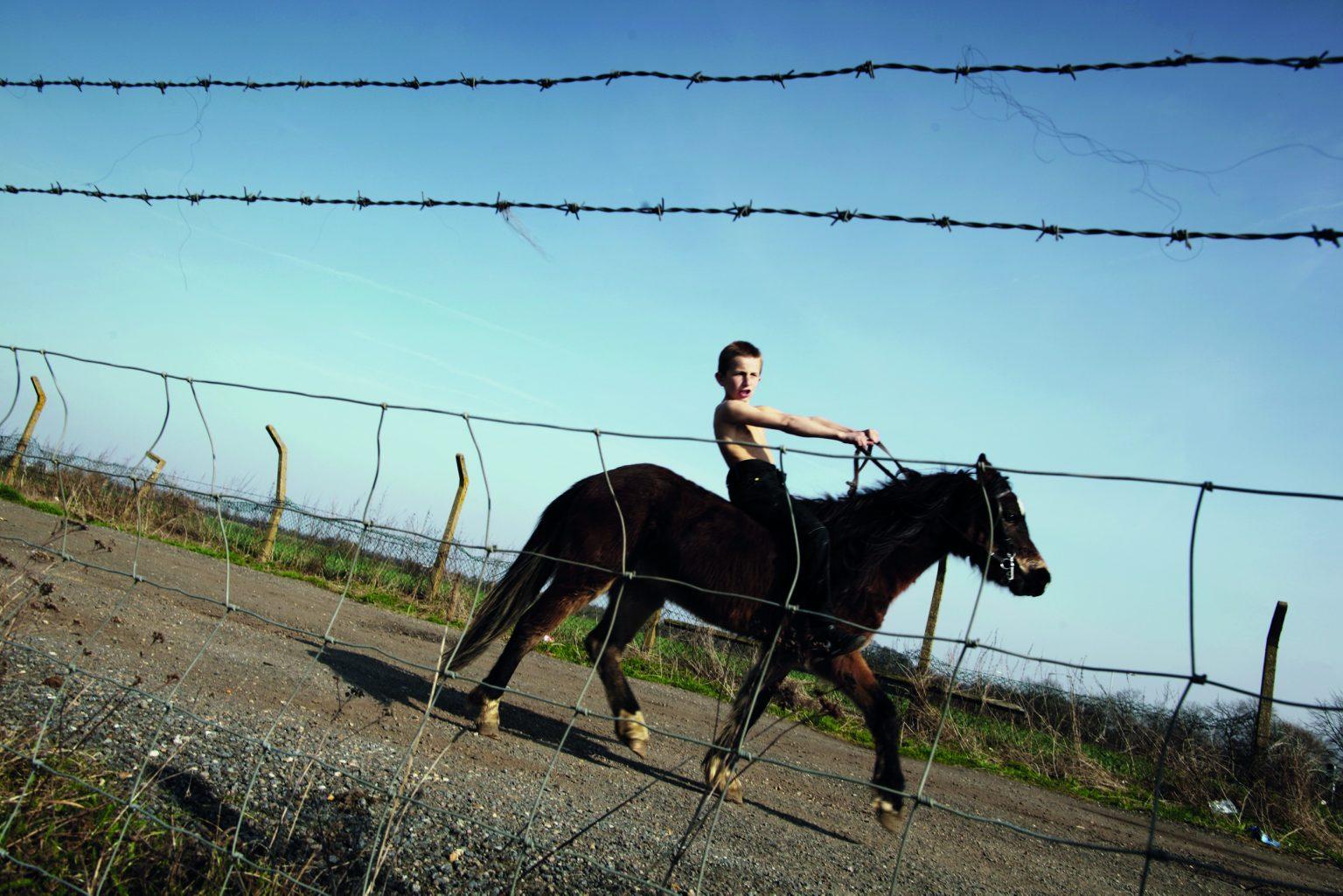Appleby, United Kingdom, June 2012 - Appleby Horse Fair. A young gypsy jockey after winning a race. ><  Appleby, Regno Unito, giugno 2012 - Appleby Horse Fair. Un giovanissimo fantino gitano dopo aver vinto una gara. *** Local Caption ***