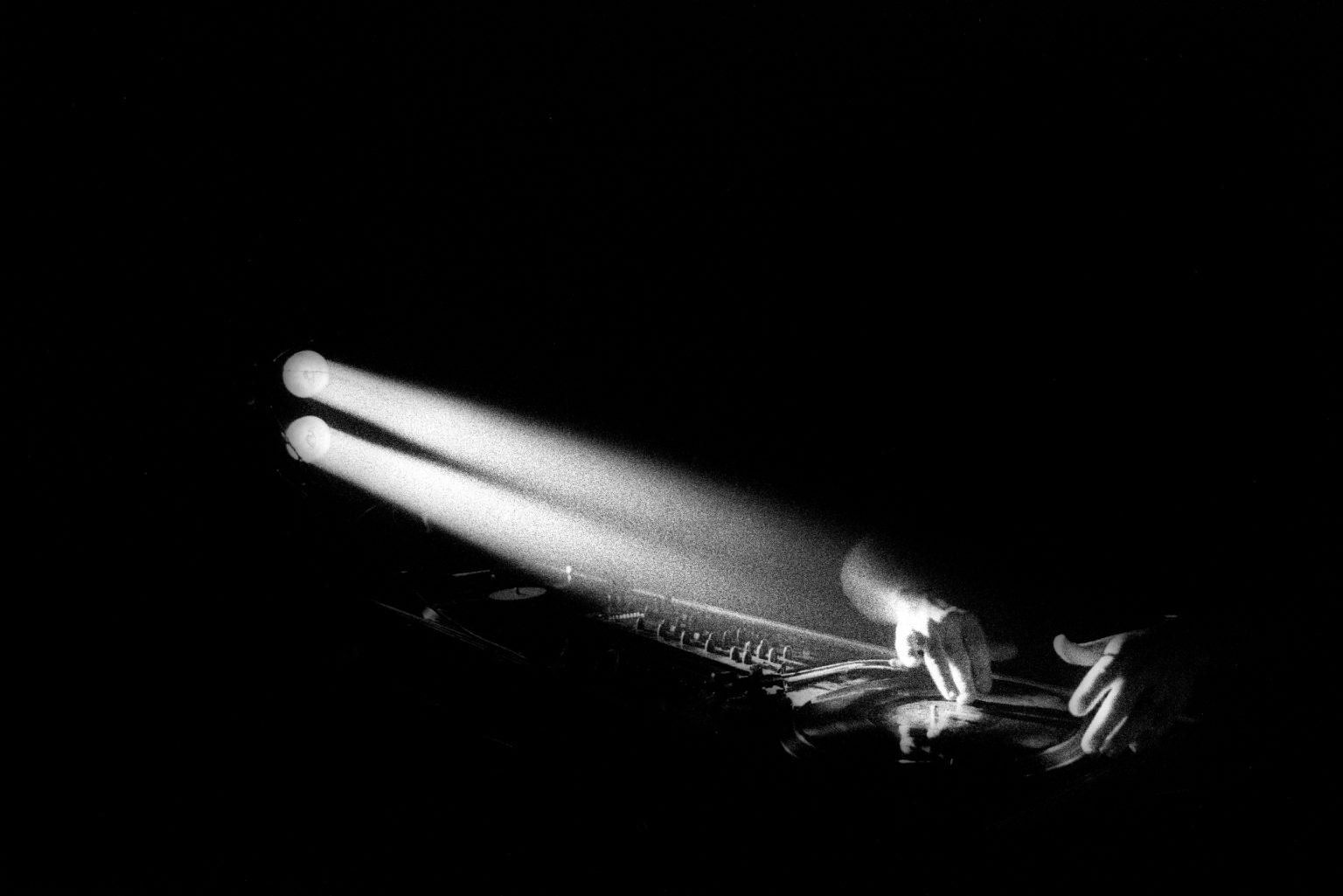 Turin, 2000 - Shockraver playing during the Summer Teknival in the riverbed of an emissary of the Po river. Shockraver is a DJ and also the host of the most important website to gather informations regarding the parties' locations. You couldn't find the party without checking out his website. >< Torino, 2000 - Shockraver suona durante il Summer Teknival nell'alveo di un emissario del Po. Shockraver è un DJ e anche l'host del più importante sito web per raccogliere informazioni sulle location delle feste. Non si poteva trovare la festa senza controllare il suo sito web.