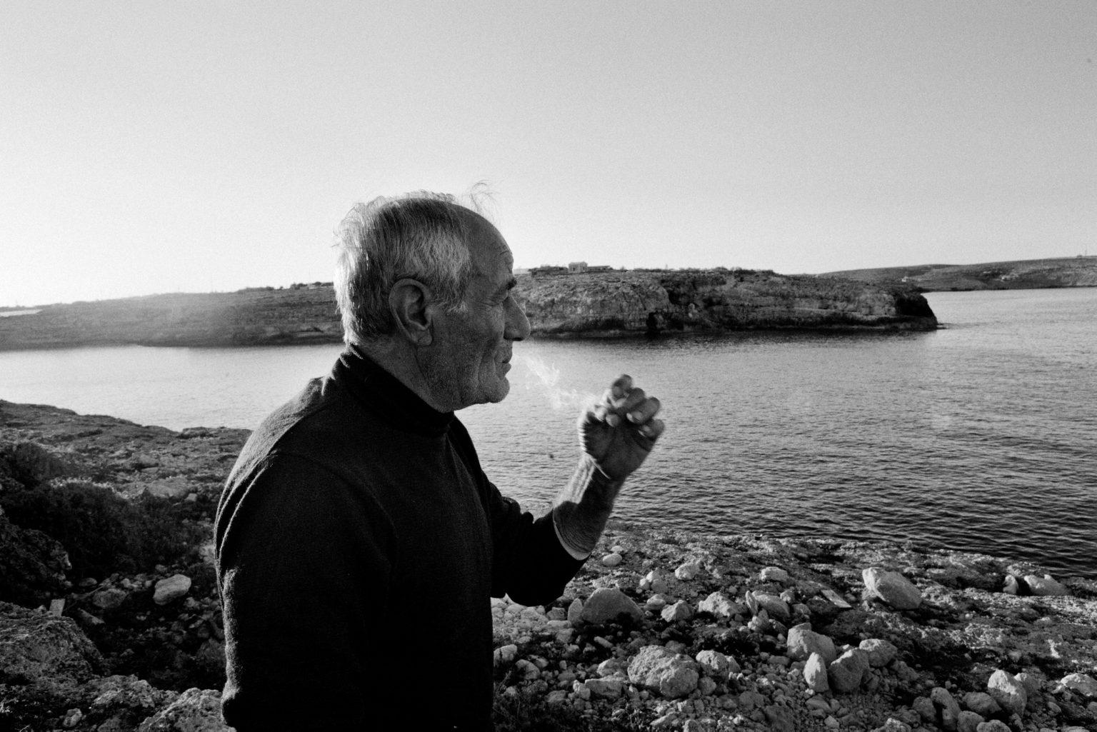 Lampedusa, April 2011-The story of Ahmed, one of the many young Tunisians landed on Lampedusa. Ahmed, a 23-year-old Tunisian who was being looked after by the Matinas, a Lampedusans family. The family gave him a bed, clothes,food, and they lived togheter for a year. Lampedusan s' Family.   Lampedusa, aprile 2011-La storia di Ahmed, uno dei tanti giovani tunisini sbarcati a Lampedusa. Ahmed, un tunisino di 23 anniè stato accudito dai Matinas, una famiglia lampedusana. La famiglia gli ha dato un letto, dei vestiti e  cibo. Hanno vissuto insieme per un anno. Famiglia di Lampedusani.