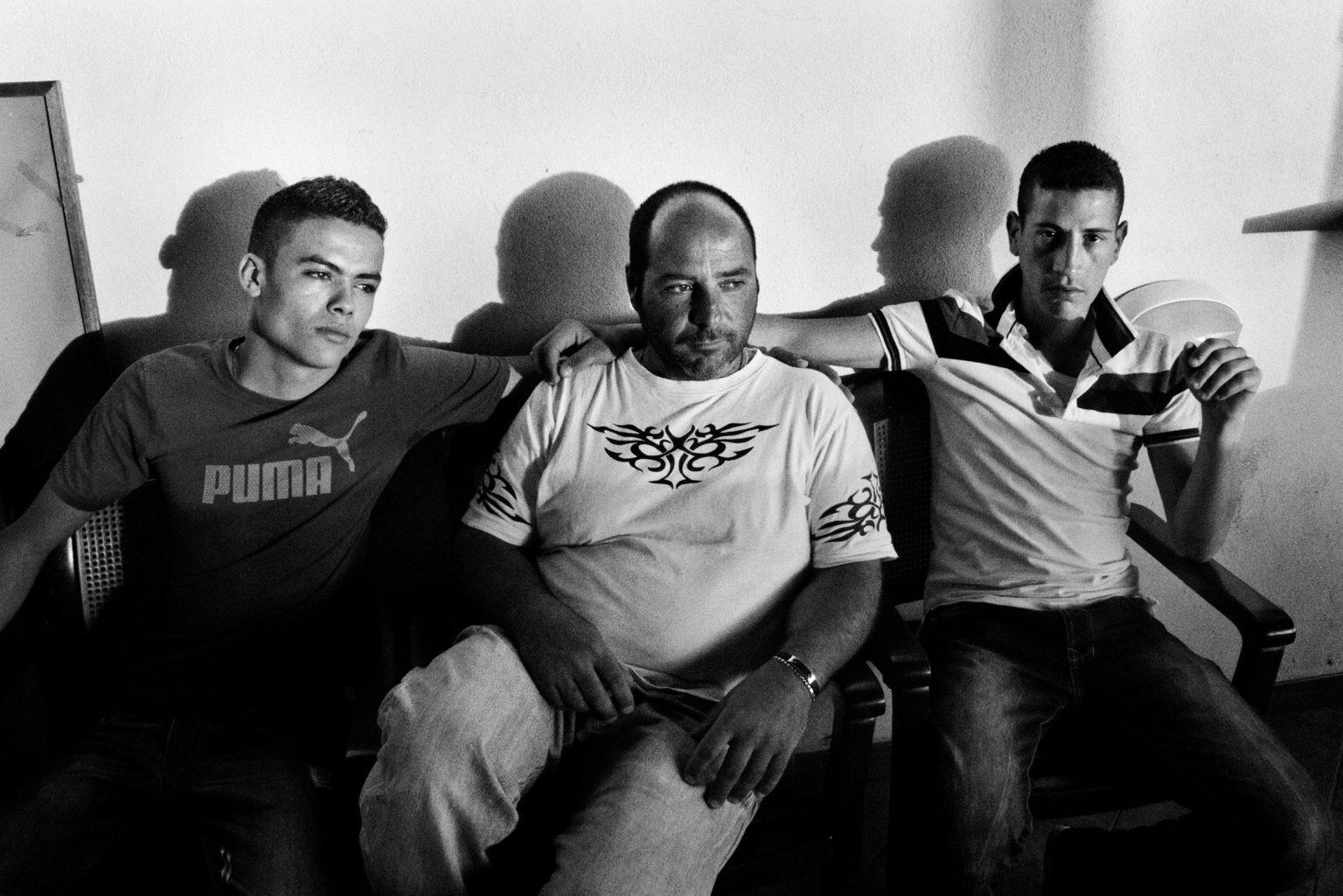 Lampedusa, April 2011-The story of Ahmed, one of the many young Tunisians landed on Lampedusa. Ahmed, a 23-year-old Tunisian who was being looked after by the Matinas, a Lampedusans family. The family gave him a bed, clothes,food, and they lived togheter for a year.Ahmed on the island.   Lampedusa, aprile 2011-La storia di Ahmed, uno dei tanti giovani tunisini sbarcati a Lampedusa. Ahmed, un tunisino di 23 anniè stato accudito dai Matinas, una famiglia lampedusana. La famiglia gli ha dato un letto, dei vestiti e  cibo. Hanno vissuto insieme per un anno.Ahmed sull'isola.