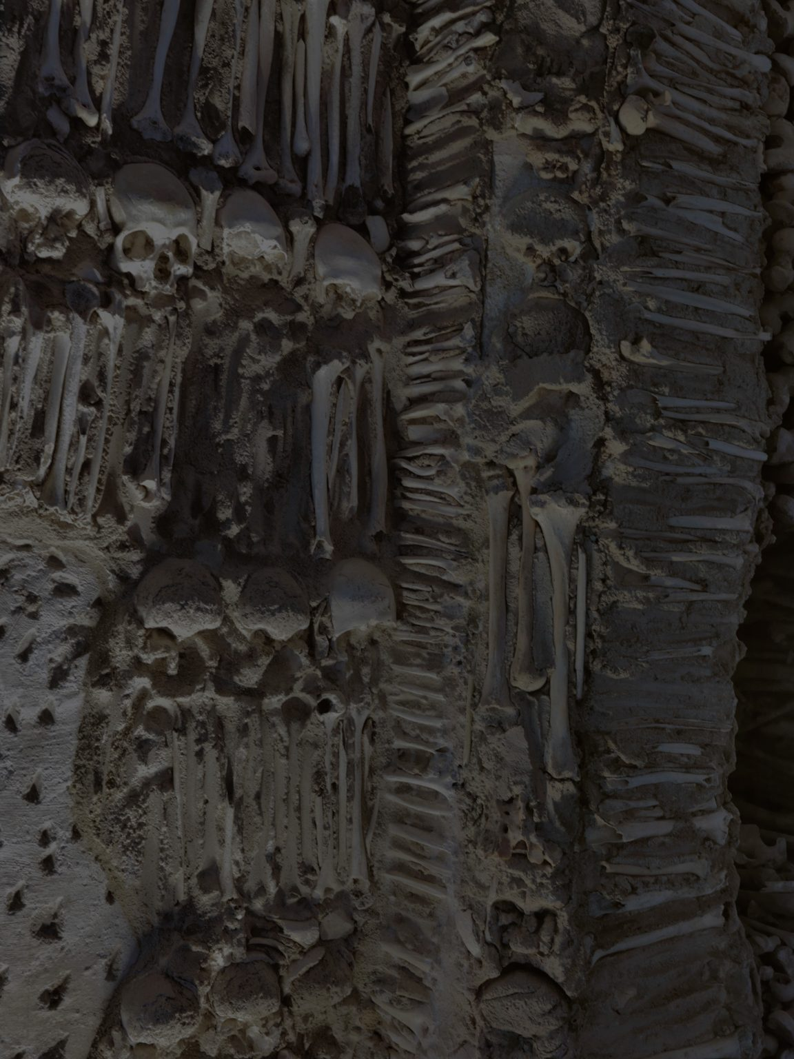 """Portugal, Alentejo, Evora, Capela dos Ossos - November 2016  The interior walls of the Chapel are covered and decorated with human skulls and bones. At the entrance a warning says """"We bones that here are, for yours await""""   """"Where are you going in such a hurry traveler? Stop … do not proceed; You have no greater concern, Than this one: that on which you focus your sight.  Recall how many have passed from this world, Reflect on your similar end, There is good reason to reflect If only all did the same.  Ponder, you so influenced by fate, Among the many concerns of the world, So little do you reflect on death;  If by chance you glance at this place, Stop … for the sake of your journey, The more you pause, the further on your journey you will be.""""  by Fr. António da Ascenção"""