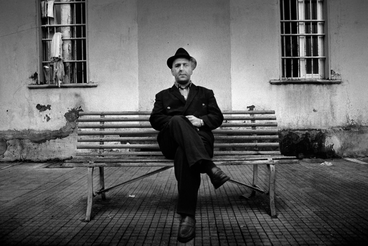 """Aversa ( Caserta ), November 2006 - The Judicial Psychiatric Hospital """"Filippo Saporito"""" - The 9th division yard: an inmate sitting on a bench during the free time"""