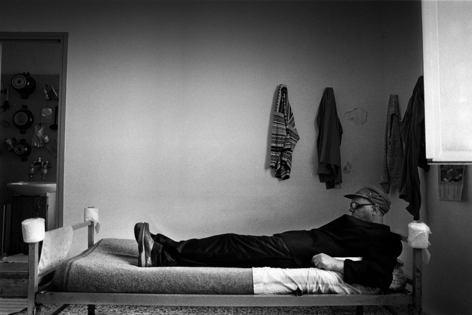 "Aversa ( Caserta ), December 2007 - The Judicial Psychiatric Hospital ""Filippo Saporito"" - An inmate lying on his bed"