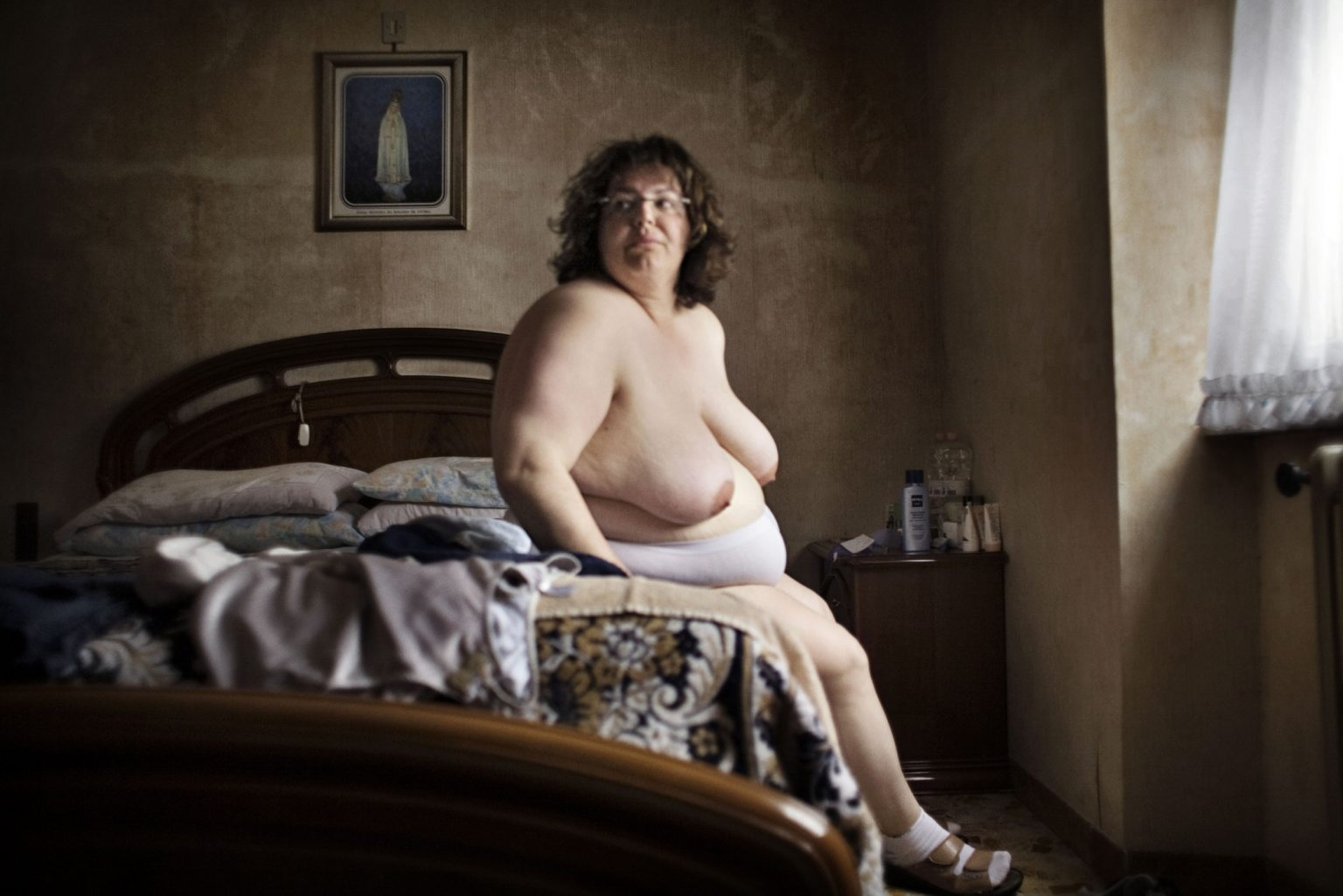San Cesareo (Rome), April 2008 - Angela, a girl suffering from a serious obesity, at home, in her room