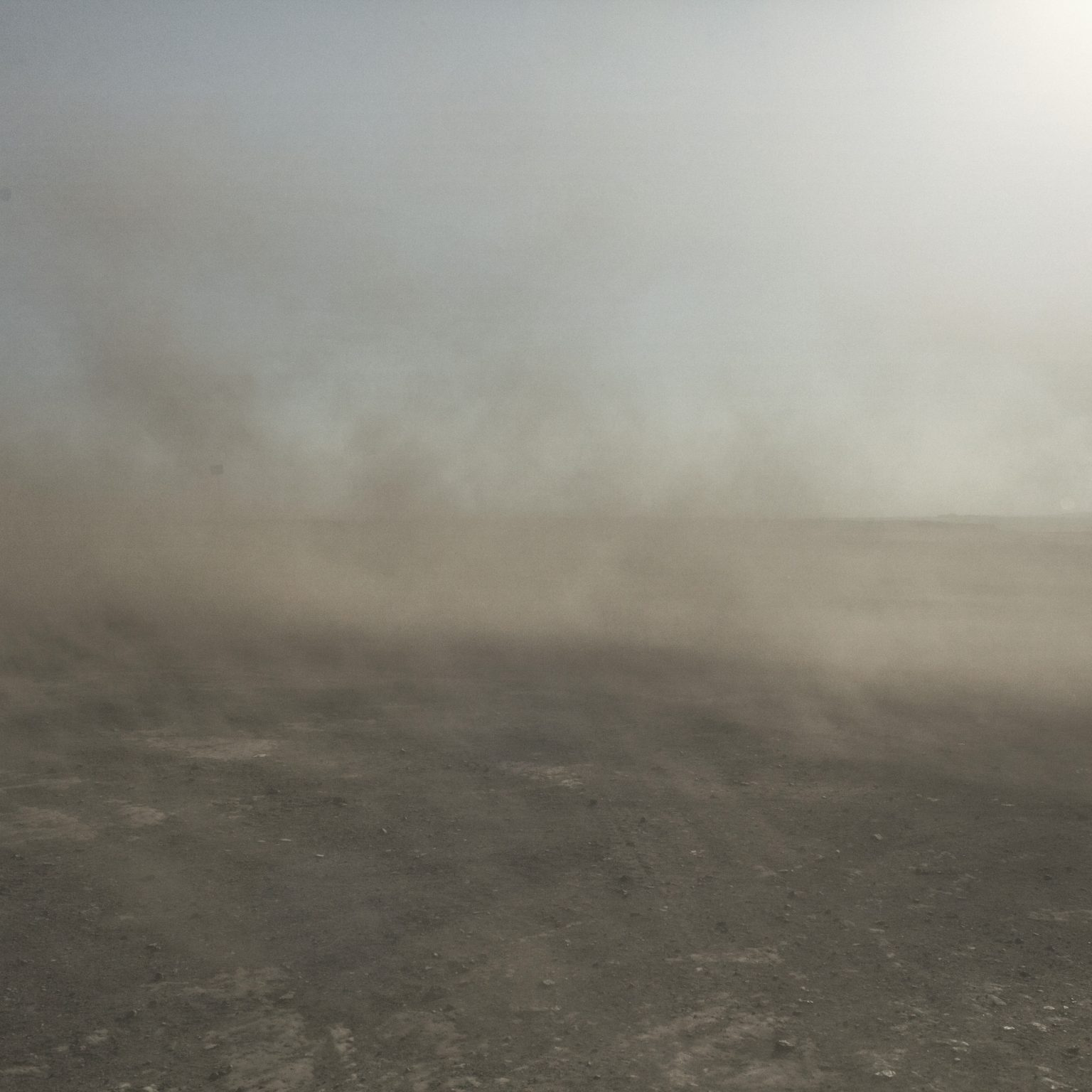 Coal dust raised by the wind in the Tavan Tolgoi Mine. Gold, coal and copper mines beckon foreign companies that work on the territory without a plan to protect the population, the fauna and the landscape. Omongov, 2013