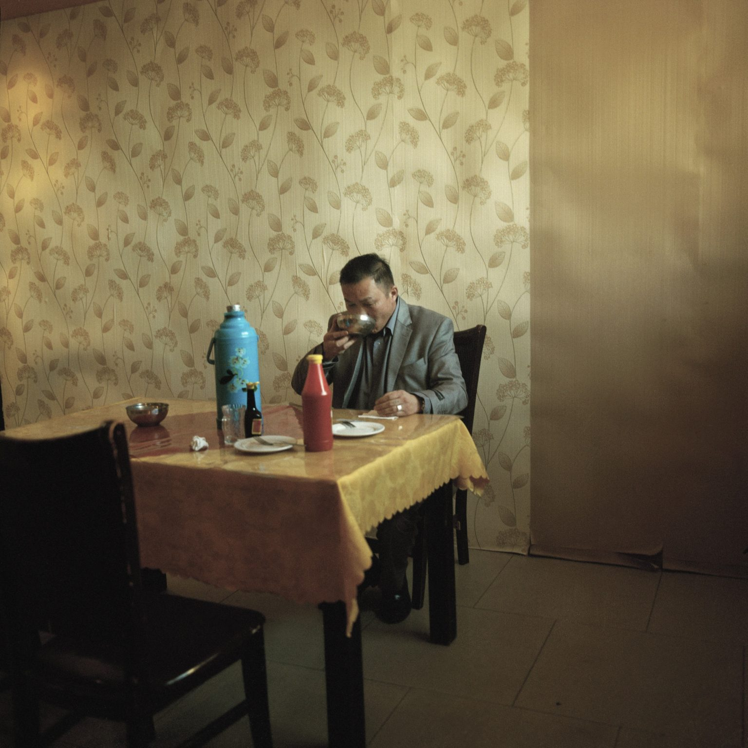 A police detective having his meal in the Police department canteen. Police often have to face with domestic violence issues almost always linked to alcohol abuse. Dalanzadgad, 2013