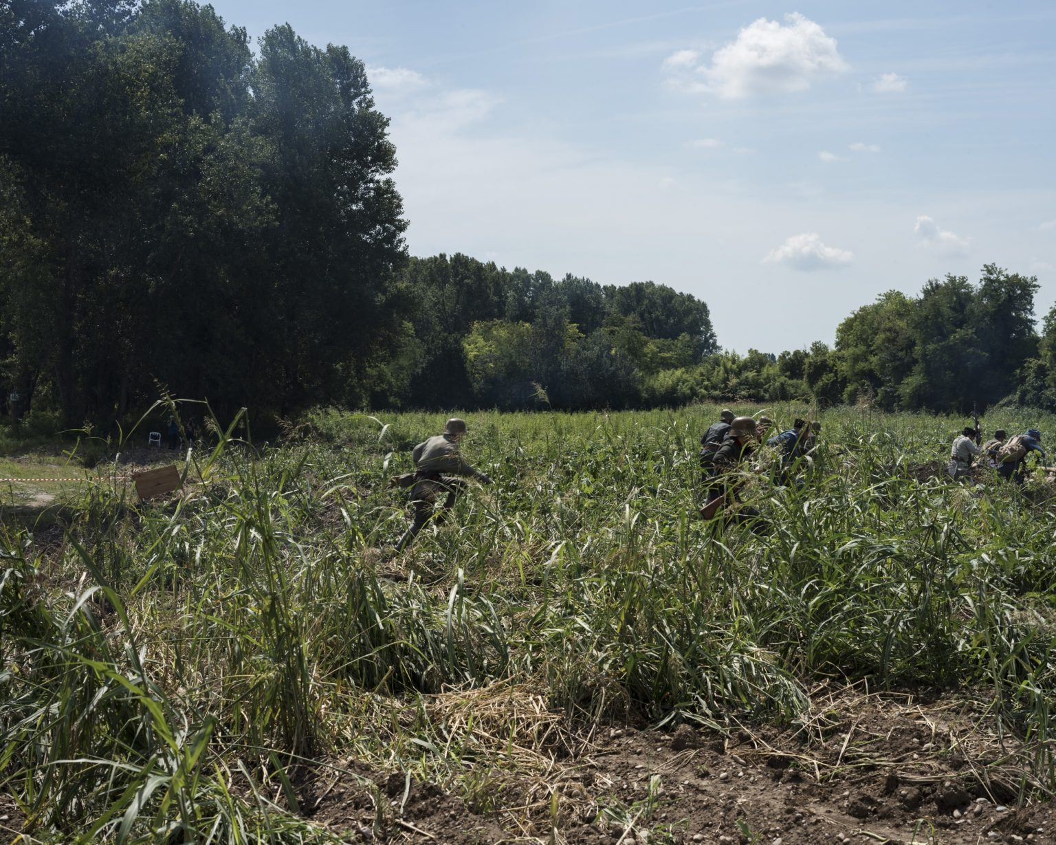 Breda di Piave (Treviso), Italy. First World War reenactment on the banks of the Piave river. Austro Hungarian and German re enactors running into the battle.