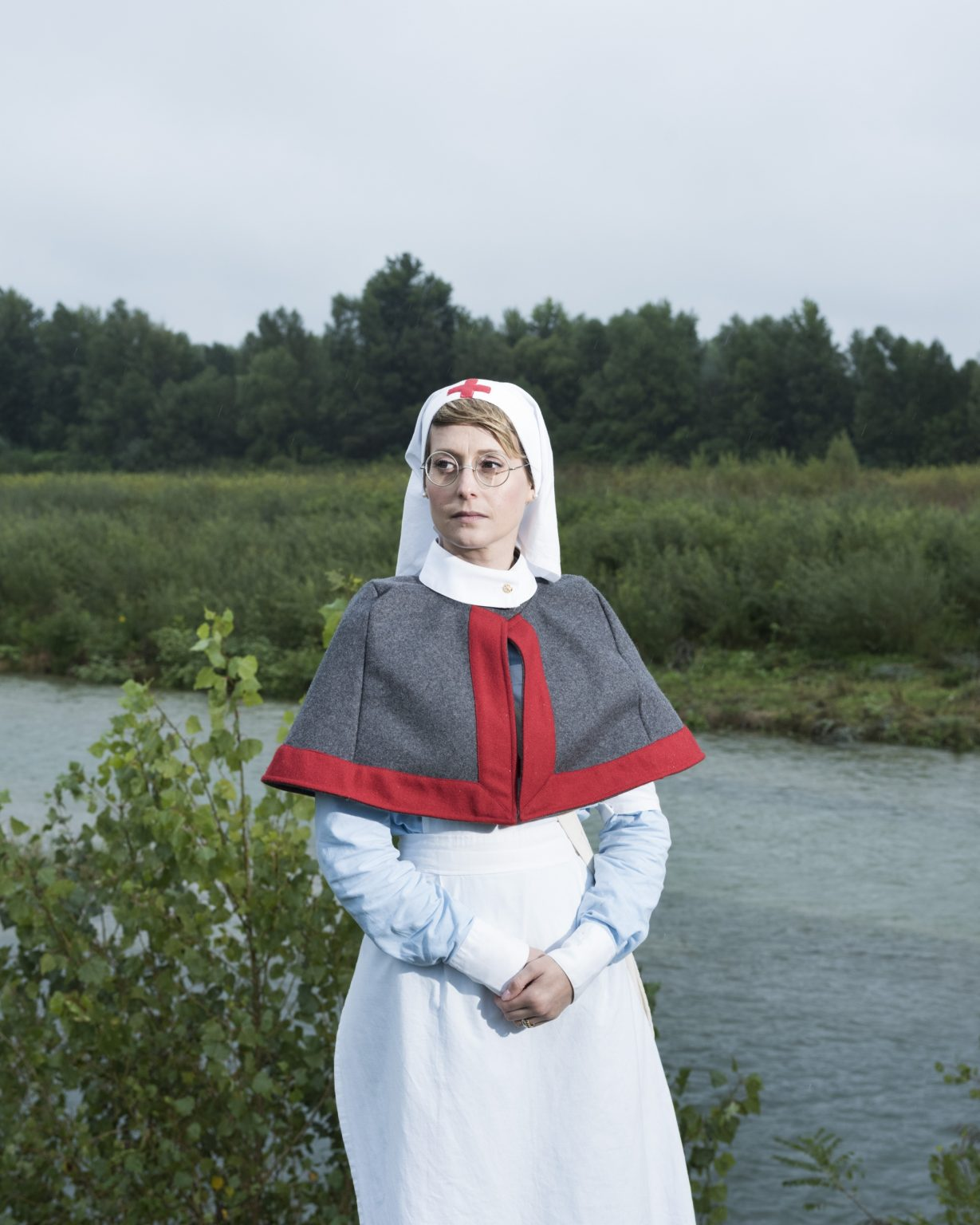 Breda di Piave (Treviso), Italy. First World War reenactment on the banks of the Piave river. Nurse reenactor.