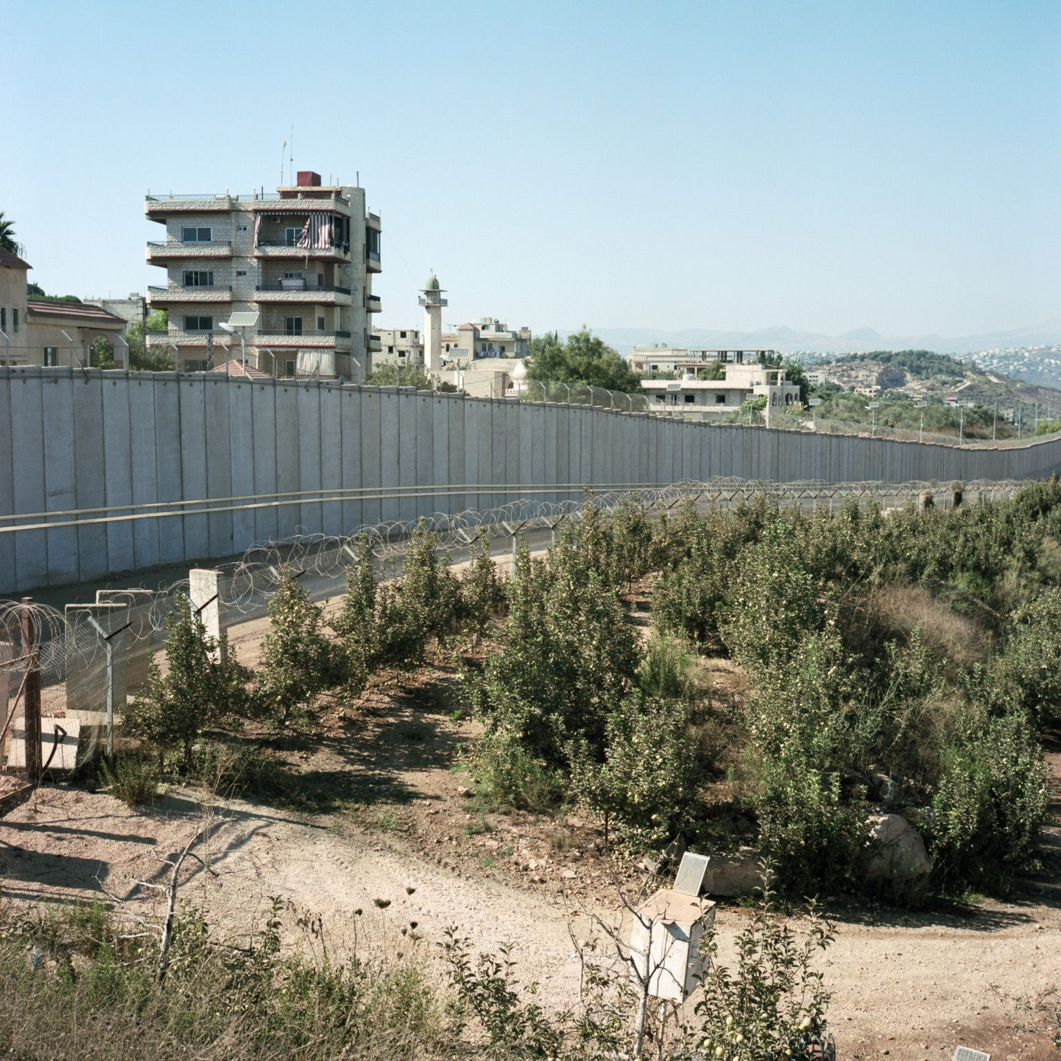 Metulla. Israel. The view from a military position of the town of Kfar Kila and the wall built along the border. The seven-meter high wall, the first of this kind along the border with Lebanon, was completed in june 2012 and it runs 1,200 meters long. It is meant to protect residents of the town from possible sniper fire or rocket attacks coming from the lebanese village of Kfar Kila, just a few meters across the border.