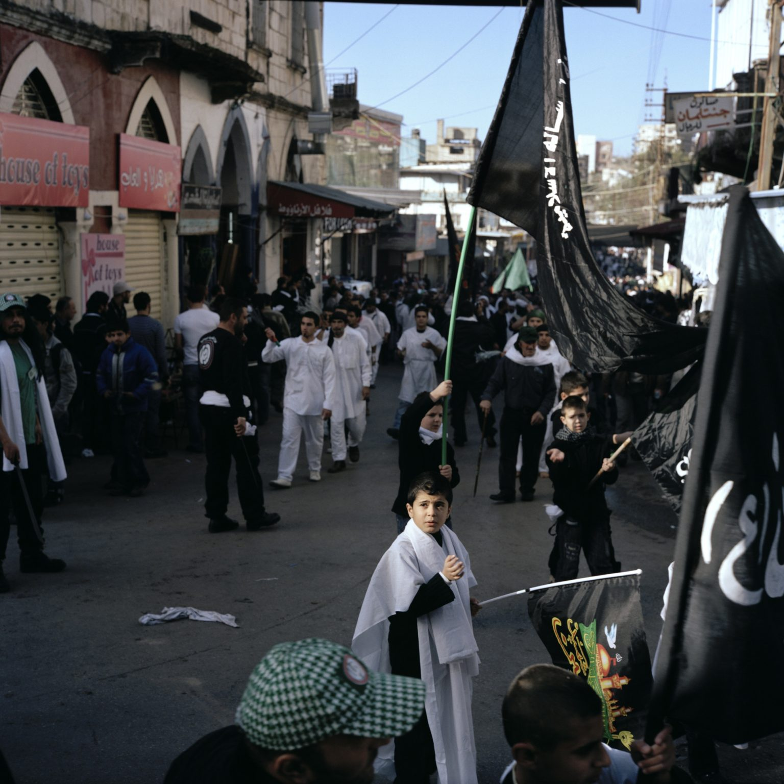 Nabatieh, Lebanon.The procession of a group of Shia celebrating Ashura in the center of the town. Ashura, the most important religious celebration for Shia Muslims. is a day of mourning for the martyrdom of Husayn ibn Ali, the grandson of the Islamic Prophet Muhammad, who died at the Battle of Karbala.