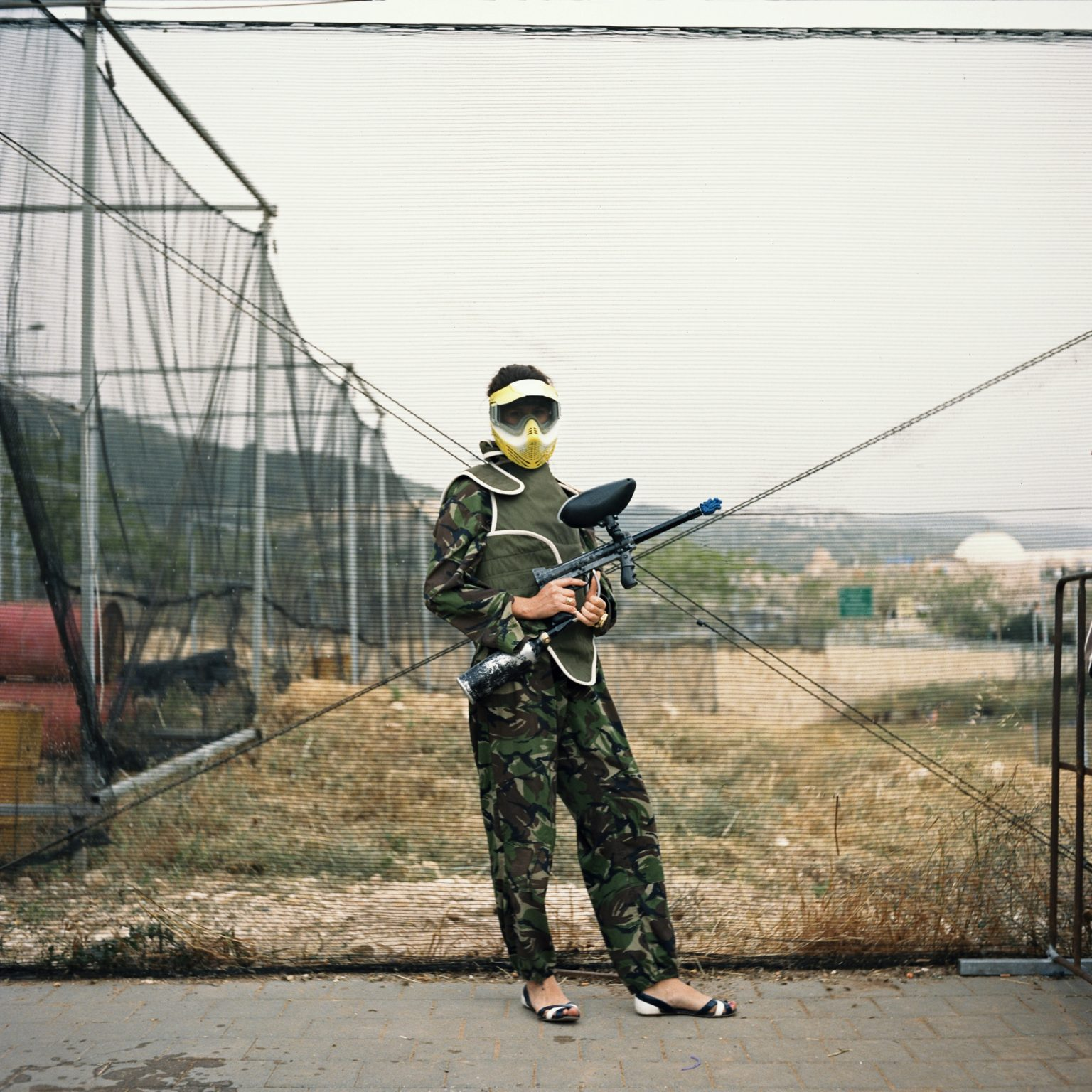 Haifa, Israel.A woman in paintball suit in a paintball shooting range in the outskirts of the city.
